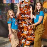Image: Set up a Halloween candy tree on your porch and let kids safely take their own treats
