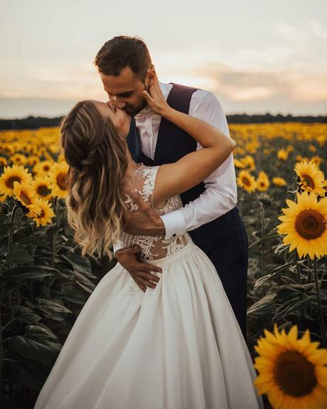 micro wedding venues groom and bride on sunflower field janasnuderl
