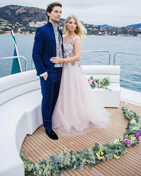 micro wedding venues groom and bride yacht with flowers kat_all
