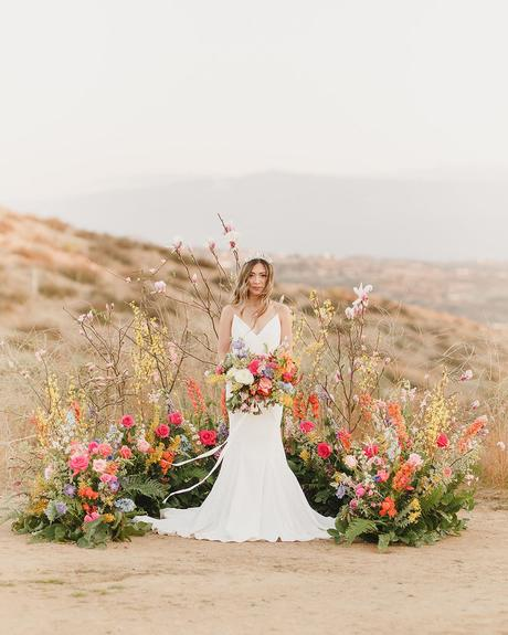 micro wedding venues altar in desert with flowers kristen booth