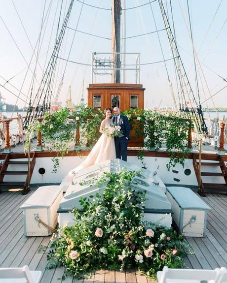 micro wedding venues yacht with greenery josh dana fernandez photography