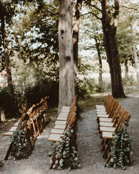 micro wedding venues ceremony chairs with greenery in park hazel eyes