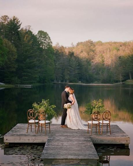 micro wedding venues groom and bride kissing on dock davy whitener