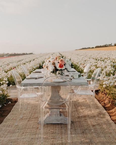 micro wedding venues table in flower field jarrod j photo