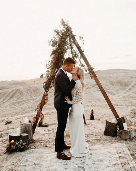 micro wedding venues boho altar in desert carly j photography