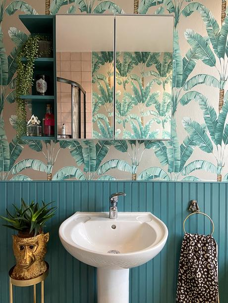 Tropical bathroom with Palmaria wallpaper by Osborne & Little and teal panelling