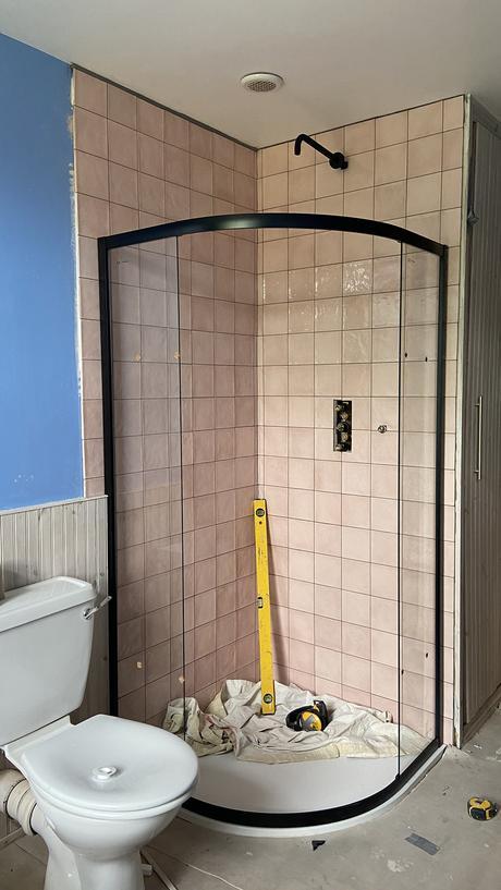 Village rose pink tiles by Tons of Tiles and black shower by Big Bathroom Shop