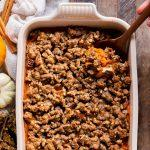 This Vegan Sweet Potato Casserole with Gluten-Free Pecan Crumble recipe is the best sweet potato casserole ever! It's made with fresh yams and coconut sugar for subtle sweetness. With a crispy gluten-free pecan crumble topping, you'll definitely be serving yourself seconds. It's easy to make the day of, or can be prepared in advance for an easy make-ahead holiday side dish.