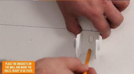 hand marking a radiator hole