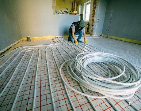 Plumber fitting underfloor heating
