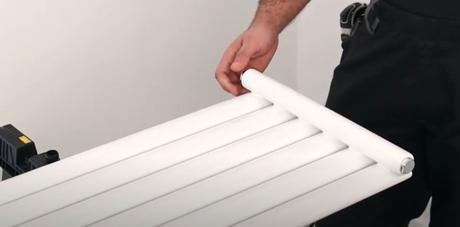 hands holding a vertical radiator