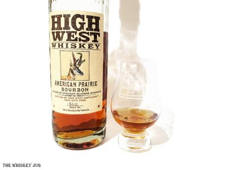 White background tasting shot with the High West American Prairie Bourbon bottle and a glass of whiskey next to it.