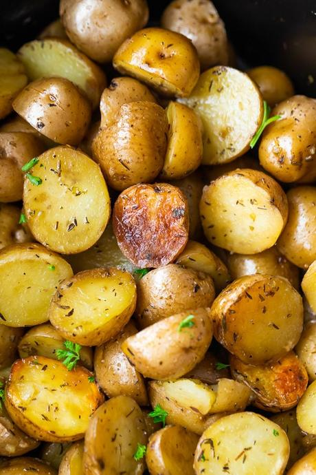 overhead shot of a pile of herb and olive oil crock pot potatoes