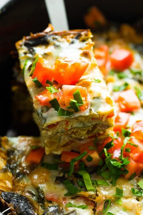 close up shot of crockpot breakfast casserole with fresh tomatoes