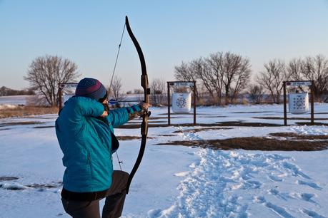 Man Shooting Recurve Bow in the Snow