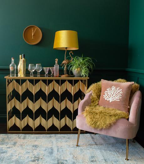 Gold chevron console table used as an alternative home bar!