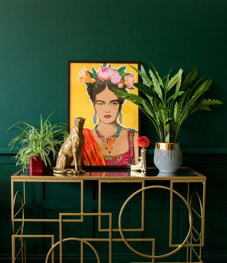 Colourful home decor. Quirky gold home accessories paired with colourful Frida style artwork