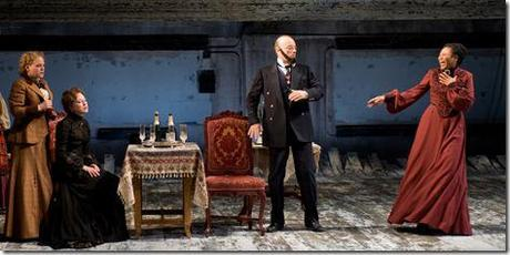 (right to left) Natasha (ensemble member Alana Arenas) is startled by Kulygin's (ensemble member Yasen Peyankov) fake beard as Masha (Carrie Coon) and Irina (Caroline Neff) look on in Steppenwolf Theatre Company's production of Anton Chekhov's Three Sisters, adapted by ensemble member Tracy Letts, directed by ensemble member Anna D. Shapiro.