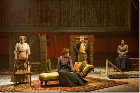 (center) Andrey (Dan Waller) confronts his sisters (left to right) Irina (Caroline Neff), Masha (Carrie Coon) and Olga (ensemble member Ora Jones) in Steppenwolf Theatre Company's production of Anton Chekhov's Three Sisters, adapted by ensemble member Tracy Letts, directed by ensemble member Anna D. Shapiro.