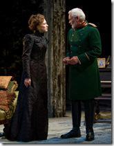 (left to right) Masha (Carrie Coon) and Vershinin (John Judd) share a private moment in Steppenwolf Theatre Company's production of Anton Chekhov's Three Sisters, adapted by ensemble member Tracy Letts, directed by ensemble member Anna D. Shapiro.