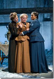 (left to right) Sisters Masha (Carrie Coon), Irina (Caroline Neff) and Olga (ensemble member Ora Jones) yearn for Moscow in Steppenwolf Theatre Company's production of Anton Chekhov's Three Sisters, adapted by ensemble member Tracy Letts, directed by ensemble member Anna D. Shapiro.