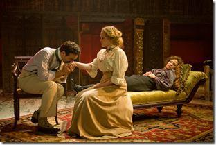 (right to left) Natasha (ensemble member Alana Arenas) speaks glowingly of her son with husband Andrey (Dan Waller) in Steppenwolf Theatre Company's production of Anton Chekhov's Three Sisters, adapted by ensemble member Tracy Letts, directed by ensemble member Anna D. Shapiro.