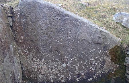 The Mysterious Engravings Of Ireland's 5,000-Year-Old Megalithic Tomb