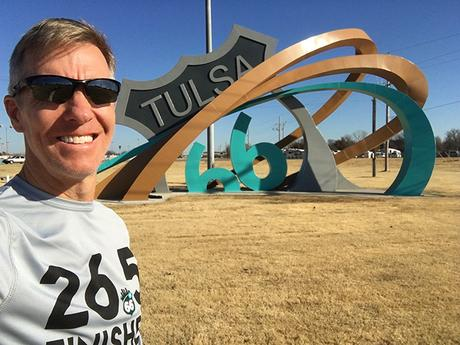 Mike Sohaskey in front of Tulsa Route 66 Rising sculpture
