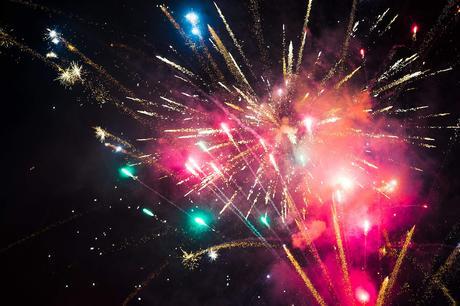 Huge Colorful Fireworks Pyrotechnics Against Black Night Sky