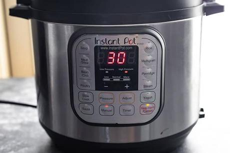 instant pot with screen that says '30'