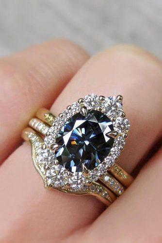 engagement ring trends 2019 oval cut colored gray diamond halo set