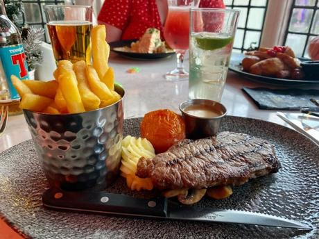6oz Sirloin Steak with grill garni, peppercorn sauce and fries Dalmeny park