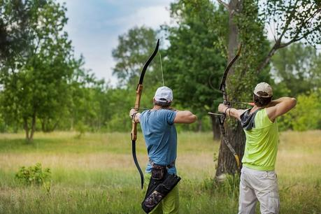 Archers shooting longbows nature