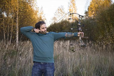 Shooting compound bow in woods
