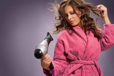 woman-using-hair-dryer