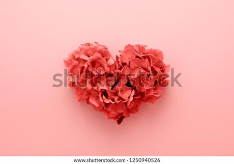 Living Coral color of the Year 2019. Heart shape made of flowers. Valentine's day. Color palette. Love fashion