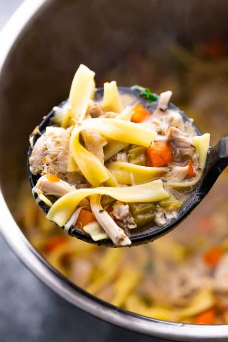 chicken noodle soup on a ladle over the instant pot