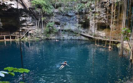 Swimmeres in X-Canche cenote in Yucatan peninsula, Mexico, Central America