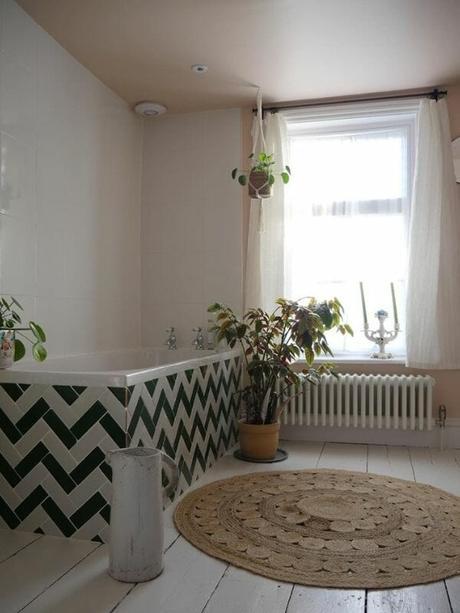 low level radiator under a bathroom window