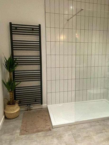 large ladder style heated towel rail in a modern bathroom