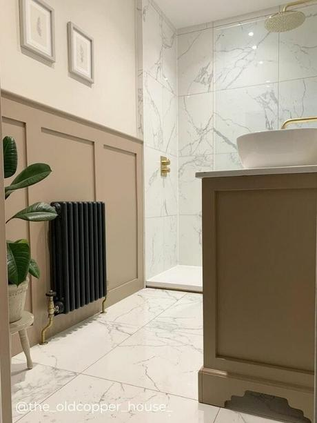anthracite column radiator in a bathroom