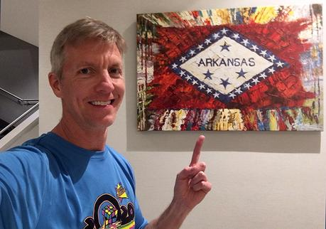 Mike Sohaskey in front of Arkansas painting