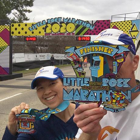 Mike Sohaskey & Katie Ho finish line selfie, proudly showing off our Little Rock Marathon medals