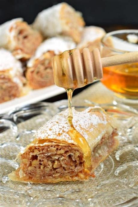 Place a silicone mat or a piece of parchment on your work surface. Sweet and flaky, this easy, rolled Russian Baklava will ...