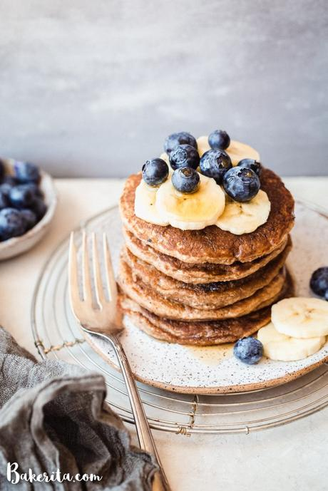 These gluten-free & vegan Banana Blueberry Pancakes are thick, fluffy, and loaded with blueberries! Made in the blender, they come together quickly and reheat well, so you can make them ahead of time for a quick breakfast.