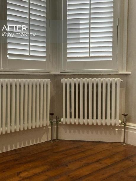 two column radiators under a window