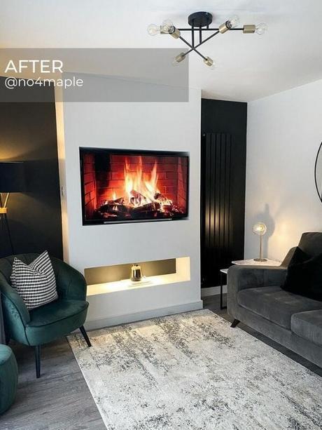 black vertical radiator on a black wall in a modern living room
