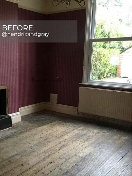 old radiator under a window in a purple living room