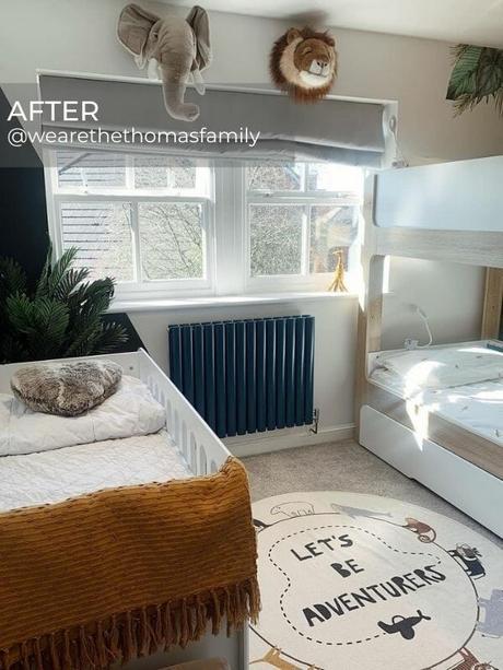 dark blue designer radiator in a modern boy's bedroom