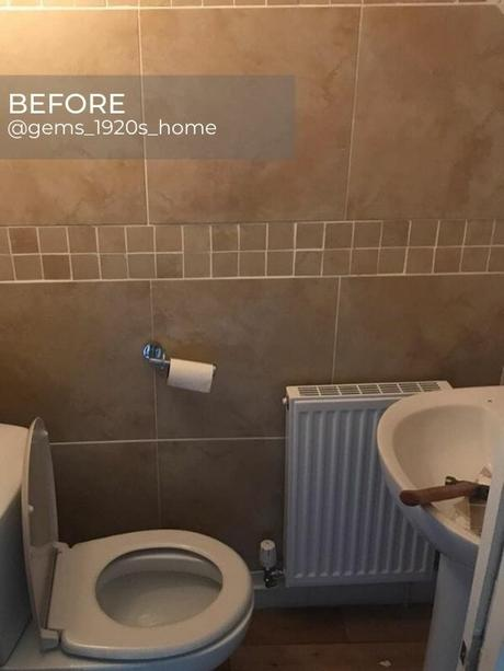 old convector radiator in a beige bathroom before the renovation